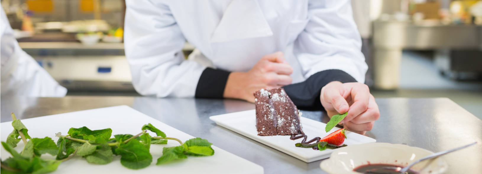 Student plating a dessert for service