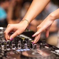 Female hands on DJ mixdesk